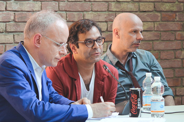 "(from left) Hans Ulrich Obrist, Asad Raza and Philippe Parreno during the round table with Maja Hoffmann and Beatrix Ruf on ""Solaris Chronicles"", the exhibition promoted by Luma Foundation in Arles and curated by Hans Ulrich Obrist"
